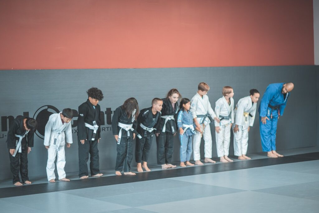 Line of kids bowing in a martial arts class