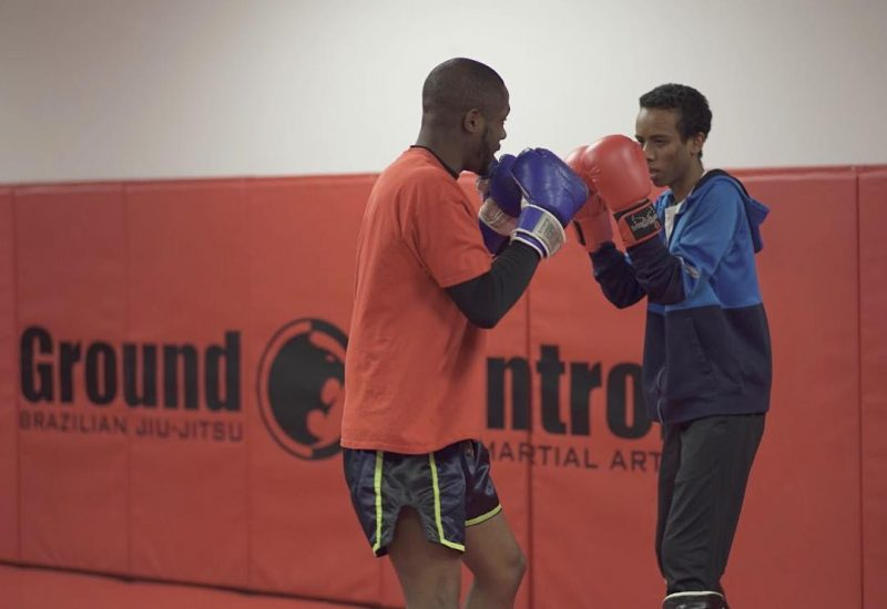 Two martial arts students sparring with punching gloves