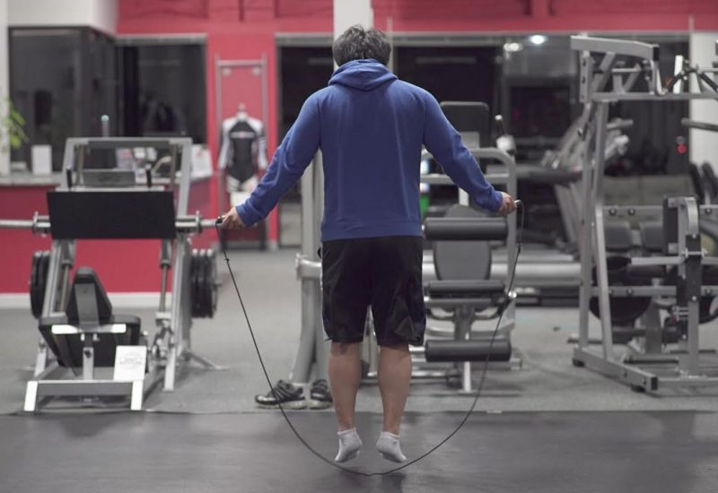 Man jumping rope inside a gym